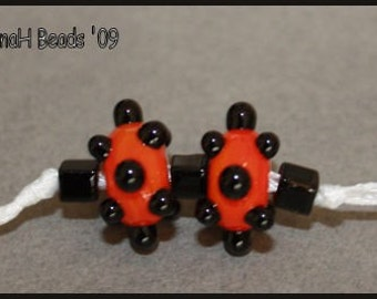 Orange and Black Bumpy Dots Handmade Glass Lampwork Beads Pair by TinaHbeads