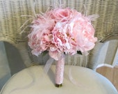 Wedding bouquet in pink silk peonies and roses, feathers and pearls, bridal bouquet