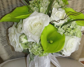 Wedding bouquet in green calla lillies and white roses, bridal bouquet