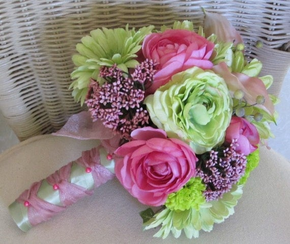 Wedding bouquet in hot pink and lime green gerbera daisies ranuculus and calla lillieslillies, bridal bouquet
