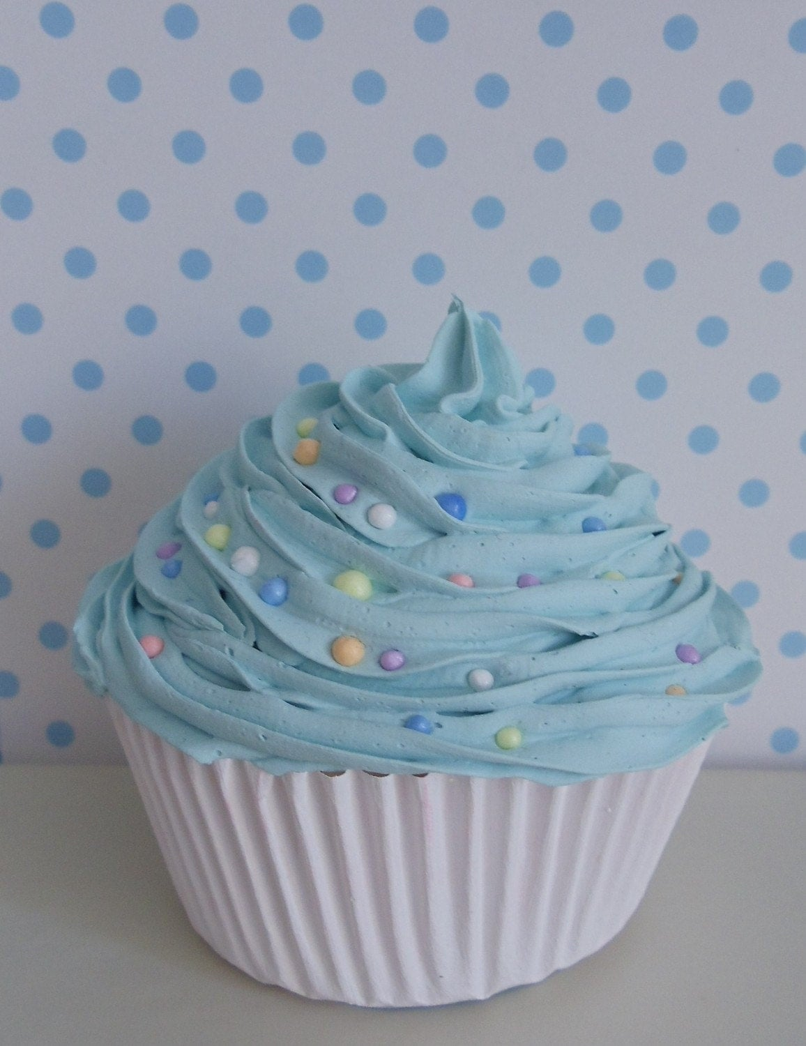 Sweet Cupcake With Light Blue Frosting With Colorful Candy For