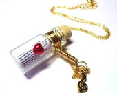 Love Song in a Bottle necklace. You Pick the Song.  Gold