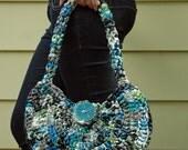 Blue, Green, White, Black, and Grey Plastic Bag Purse
