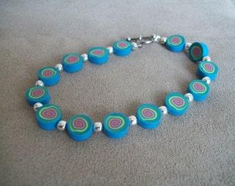 Polymer Clay Wire Strung Bracelet, Bright Spirals