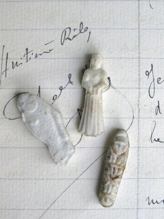 Three Porcelain French Feves for the Epiphany, Served in a Gateau des Rois