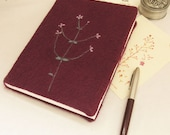 handmade felted wool notebook in purple decorated with blooming branch