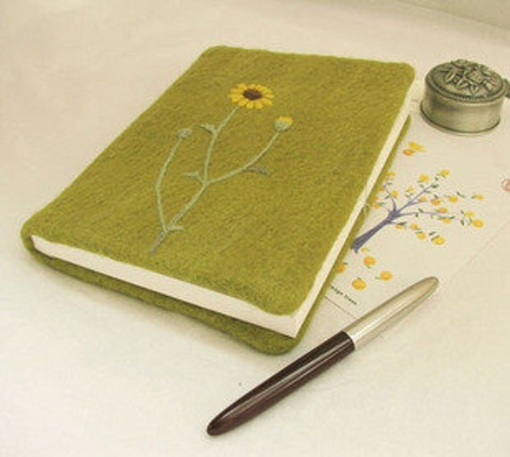 handmade felted wool notebook  in yellowish green decorated with commen daisy
