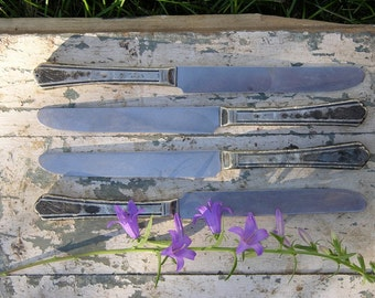 Tarnished silver knives