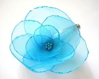 aqua poppy flower snap clip