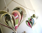 Altered book garland hearts Shakespeare pink green