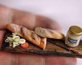 Sandwich in the making on rustic board