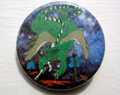 1 1/4 inch Karmic Payback Dragon Chomping Down on St. George and His Horse Pinback Button Pin