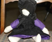 Amish doll in purple dress