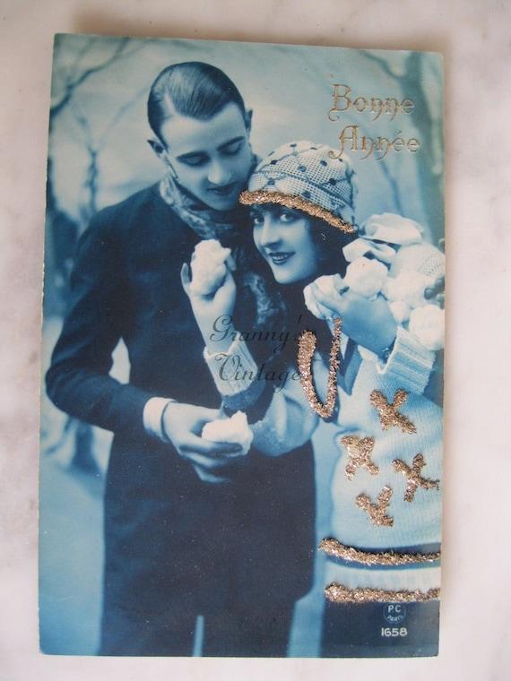 Antique Hand Tinted French Photo Postcard.From the album Marthe -Camille. P.C.Paris.Bonne Annee.Snow fun.Glitter. 1925