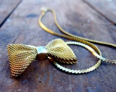 On hold for krista          Vintage Sweet Golden Bow Necklace