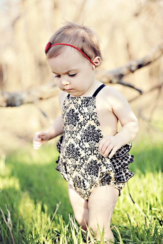 Vintage style sun suit romper, with ruffles, cream damask print with black plaid ruffles,  in sizes 6m, 12m, 18m, 2T, and 3T