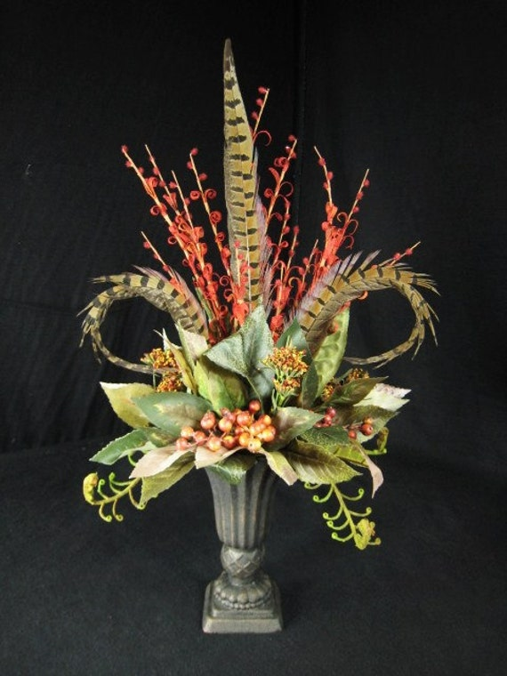 Pheasant feather berry and fiddlehead fern floral urn