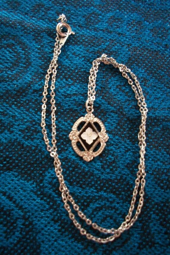 Vintage Necklace - Carved flower on enamel background, detailed silver tone pendant