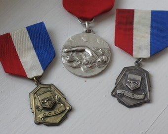 vintage swim medal with ribbon