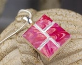 CLEARANCE- Fabric Necklace-  Embossed Metal with Inlaid Marbled Pink Fabric and Resin Scrabble Pendant  - Wood-backed