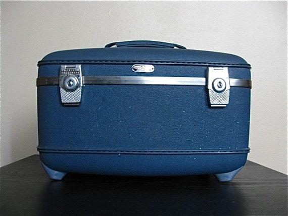 Blue American Tourister Vintage Train Case.