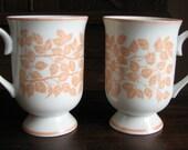 Vintage 2 Holt Howard Pedestal Coffee Mugs in Peach Leafy Vine Design