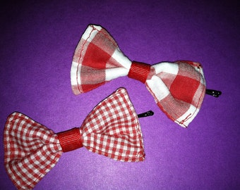 Pair of small red and white checkered hairbows on bobby pins