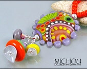 """MICHOU Anderson Lampwork Jewelry - """"Happy go Lucky"""" Pendant in purple, red, green and rose by Michou"""