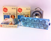 Vintage camera supplies.  Flashes and Flashulbs.  GE AG 1B, Sylvania, and more.