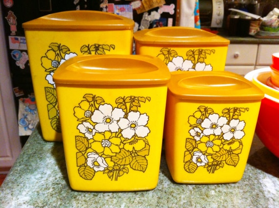 Vintage floral canisters.  Set of 4.  Square canisters nest inside each other.  Yellow flowers.  Retro kitsch.