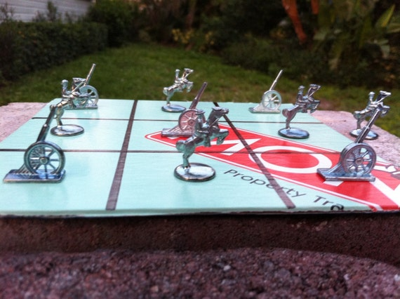 Monopoly tic tac toe game.  Soldier vs cannon.  Made from vintage game pieces and a real board game.