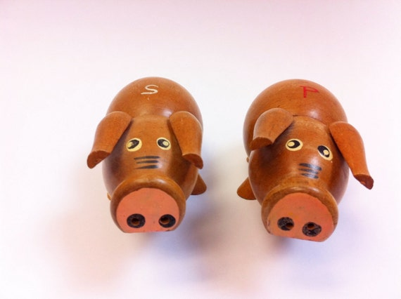Vintage pig salt and pepper shakers.  Cute pigs with big noses.  Wood.  Retro kitsch.