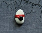 stone office desk accessory white red twine wrapped rock
