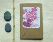moleskine notebook  pink and gray text and heart