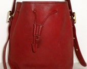 Vintage XL red Coach leather bucket draw string purse.