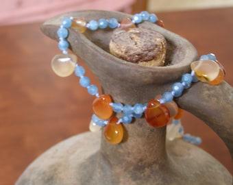 Casual blue necklace with orange carnelian drops