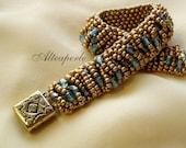 Golden and light blue beadwoven cuff bracelet