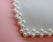 5 inches White Pearl Trimmed Feather Fascinator Base.