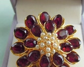 Fabulous Swoboa Fashion Dinner Ring depicting a dahlia blossom of garnets