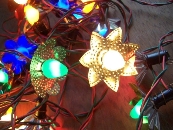 Christmas tree light strand with alunimun reflectors pierced
