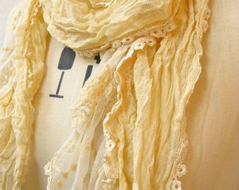 The summer crinkle cotton scarf with lace trimming, light yellow color