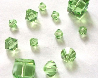 Sale/Destash -- 12 Swarovski crystal beads 4/6/8mm BICONE/CUBE -- PERIDOT (August Birthstone)
