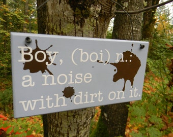 Boy Definition Sign...a noise with dirt on it.