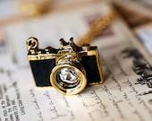 a Black Vintage camera necklace
