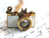 a White Vintage camera necklace