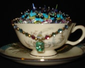 altered cup and saucer pretty as a peacock
