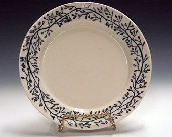 Porcelain ceramic pottery plate with floral design.
