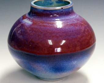 Porcelain artist vase  with electric red and blue