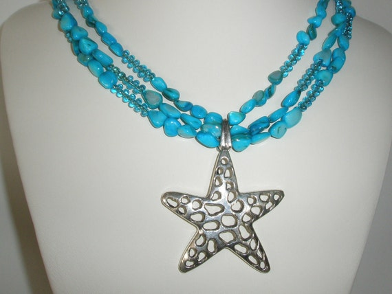 Star fish necklace with triple strand  Aqua Blue mother of peal.