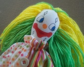 Sweet clown doll with green and yellow hair